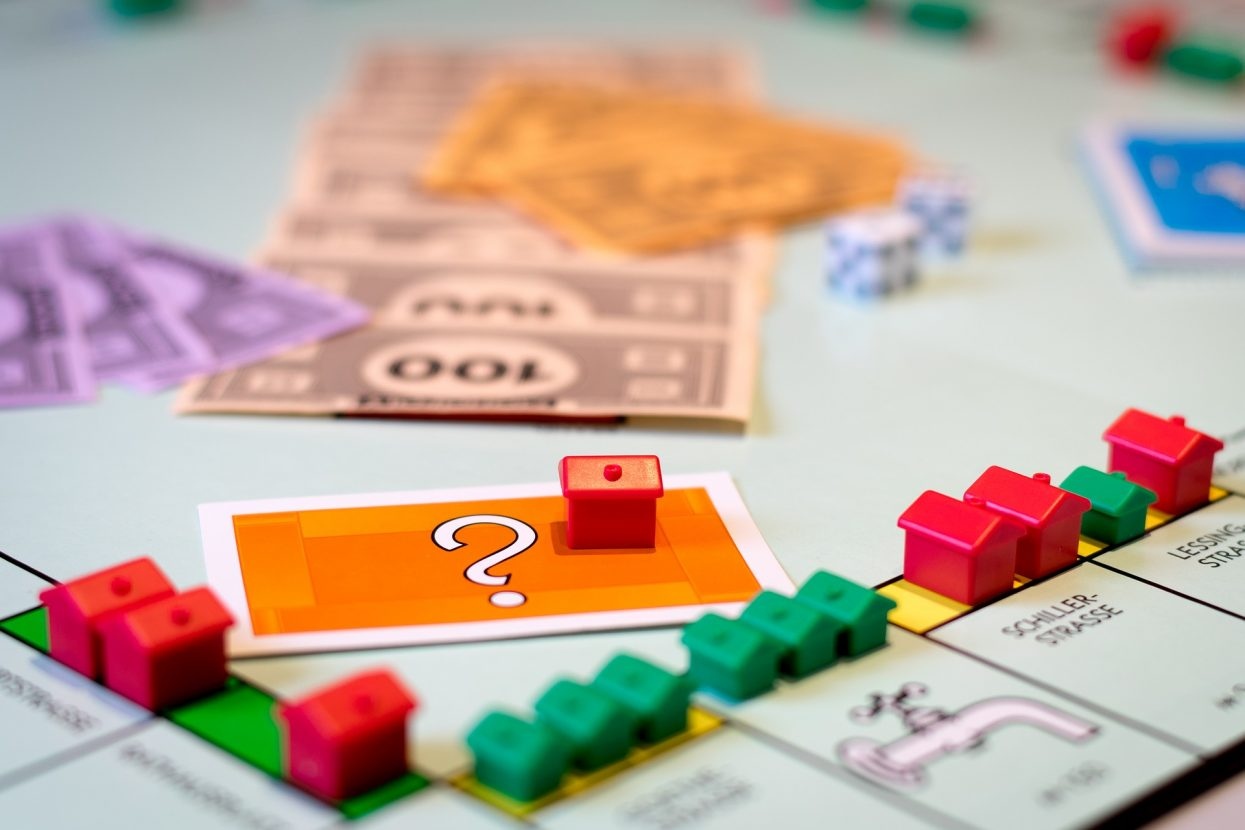Monopoly board loaded with red and green houses and hotels