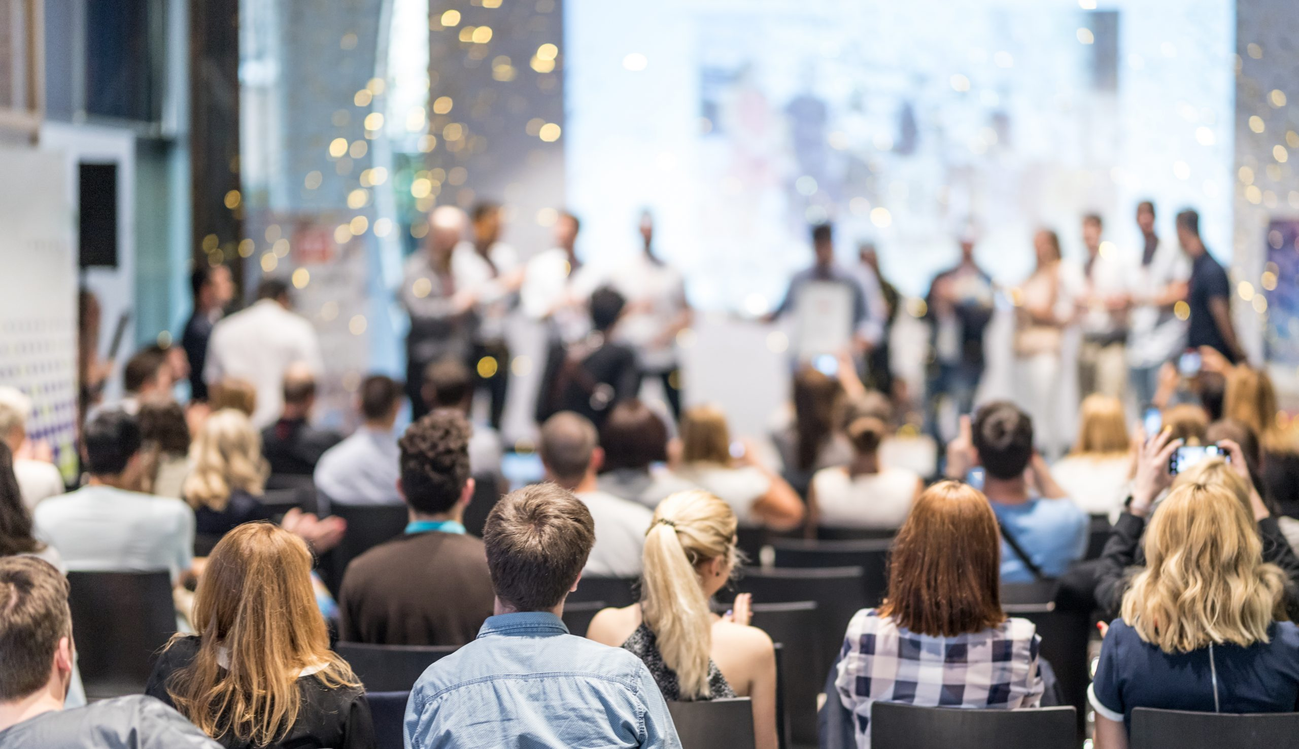 people cheering at an award ceremony